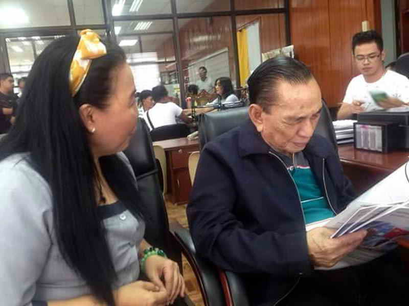"""The Governor Amor D. Deloso, the Governor of the Province of Zambales, is reading the """"Sophy Poetry & Translation"""" at the provincial capitol of Zambales, Philippines"""